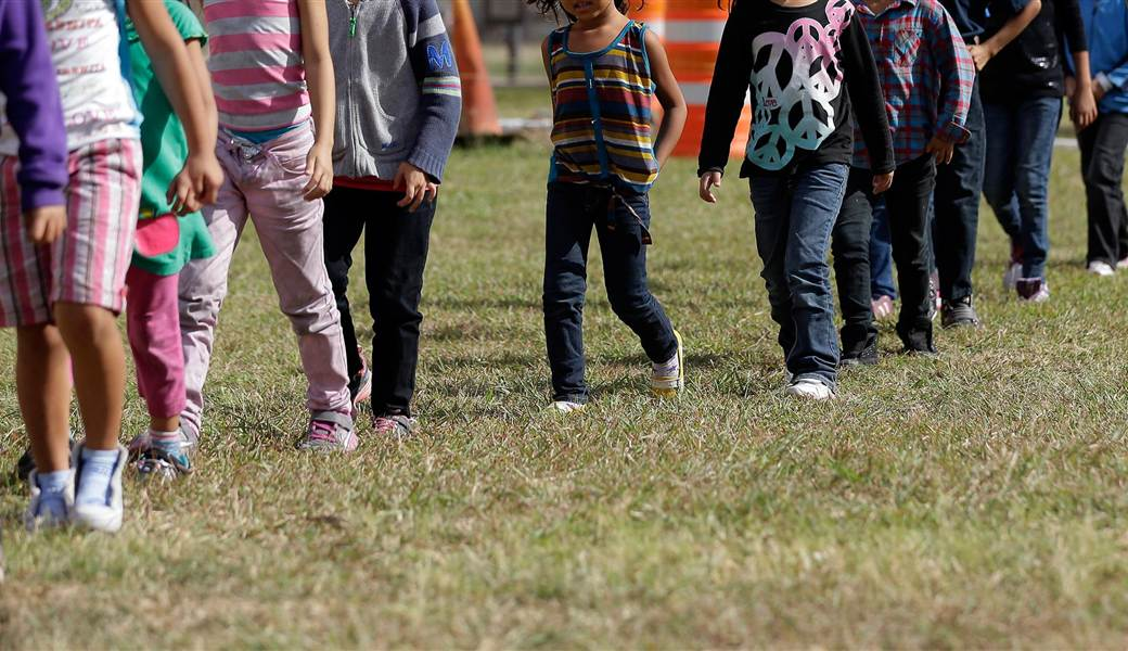 children crossing border